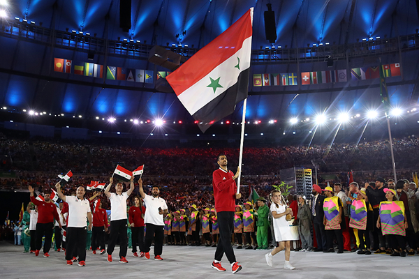 Majd Eddin Ghazal carries the Syrian flag during the opening ceremony of the Rio 2016 Olympic Games (Getty Images)