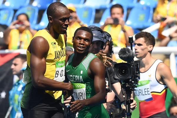 Usain Bolt and Divine Oduduru after their 200m heat at the Rio 2016 Olympic Games (AFP / Getty Images)