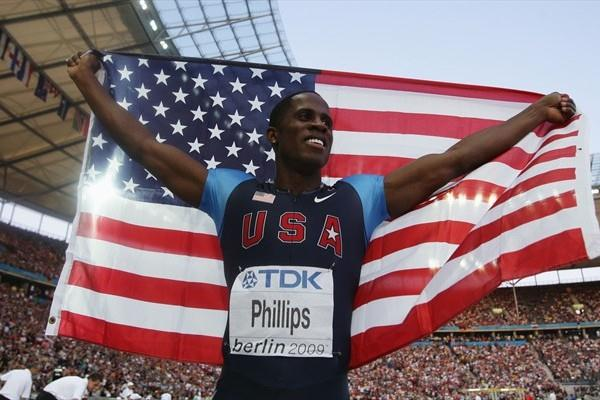 Dwight Phillips of the USA celebrates winning the gold medal in the men's Long Jump final in the historic Berlin Olympic Stadium (Getty Images)