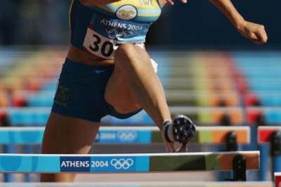 Carolina Kluft of Sweden in action in the 100m Hurdles in the Heptathlon (Getty Images)