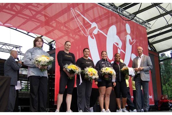 Nadezhda Ostapchuk (left) heads up the women's Shot Put prize ceremony in Stockholm (Chris Turner)
