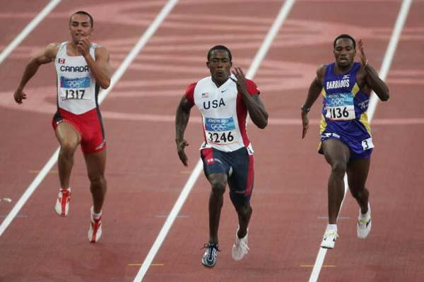 Shawn Crawford and Obadele Thompson in the men's 100m quarter finals (Getty Images)