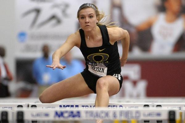 Brianne Theisen hurdling in the Pentathlon at the 2011 NCAA Indoor Champs (Kirby Lee)