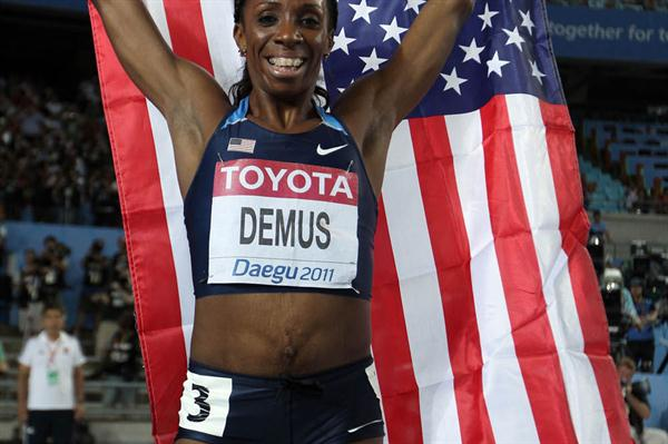 Lashinda Demus of United States celerates with her country's flag after claiming gold in the women's 400 metres hurdles final  (Getty Images)