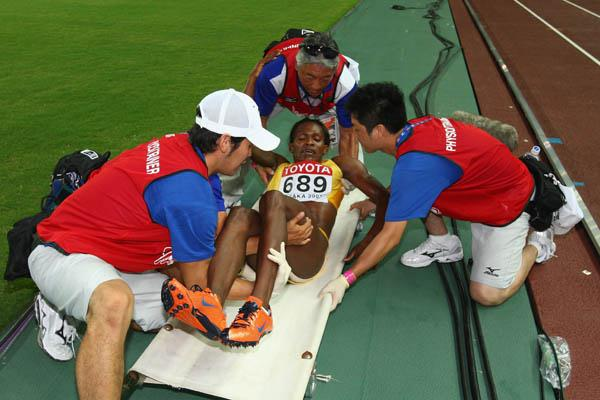 Maria Mutola is stretched out after she failed to finish the 800m final (Getty Images)