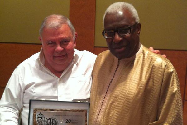 Roberto Gesta de Melo, Area Representative for South America on the IAAF Council, presents President Lamine Diack with a plaque to mark his support for the Brazilian Federation during the 26 years that Mr. De Melo was the federation's President. Roberto Gesta de Melo stood down from the position earlier this year. (IAAF)