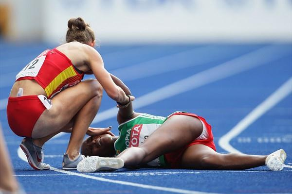 Spain's Natalia Rodriguez comforts Gelete Burka of Ethiopia who fell in the women's 1500m final (Getty Images)