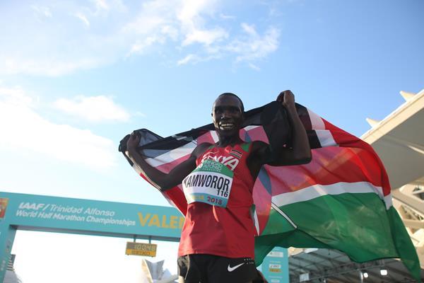 Geoffrey Kamworor after his third straight world half marathon title (Jean-Pierre Durand)