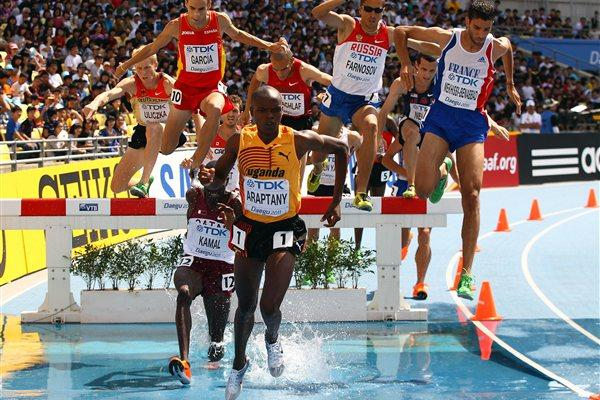 Jacob Araptany of Uganda leads the pack into the water during the men's 3000 metres steeplechase heats during day three  (Getty Images)