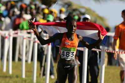 Rampant victory! Lornah Kiplagat wins the women's senior race in style (Getty Images)