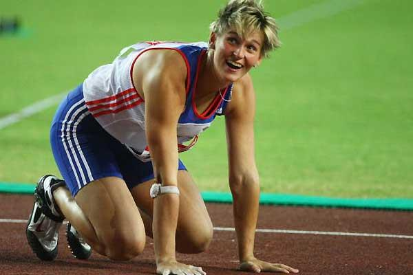 Barbora Spotakova (CZE) kneels after throwing in the final which she won (Getty Images)