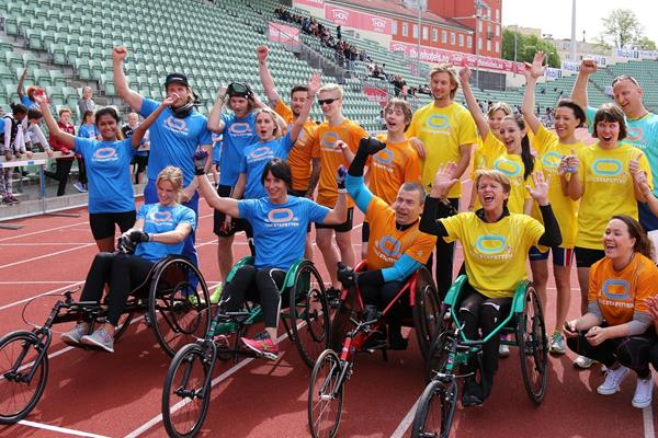 Paralympic relay participants with 2014 Winter Olympic Games gold medallists Marit Bjoregen and Kjetil Jahnsrud at the Bislett Stadium (Norwegian athletics federation)