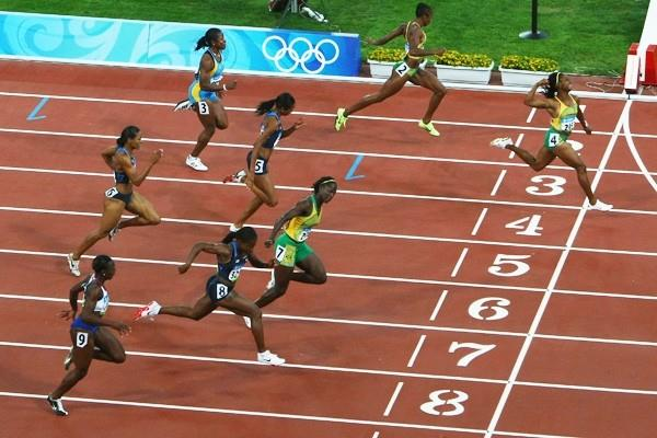 Shelly-Ann Fraser wins the 100m by more than two metres to lead a Jamaican medal sweep with Sherone Simpson and Kerron Stewart sharing the silver (Getty Images)