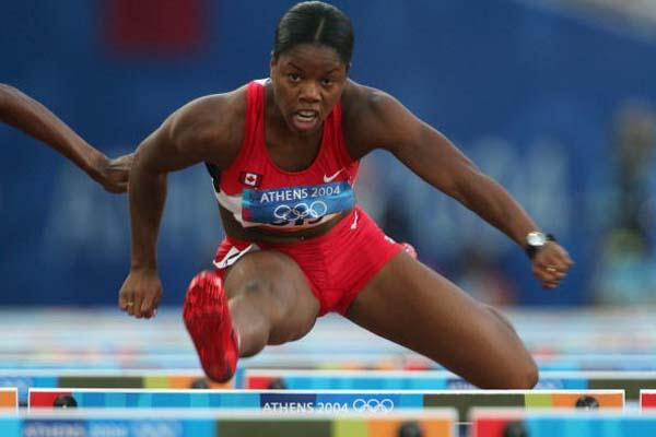 Perdita Felicien of Canada in the heats of the 100m Hurdles (Getty Images)