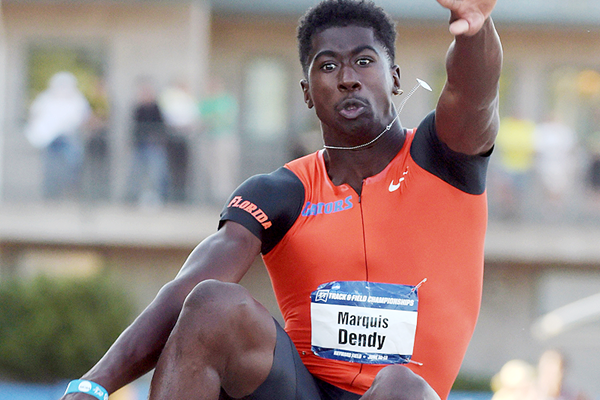 Marquis Dendy wins the long jump at the NCAA Championships (Kirby Lee)