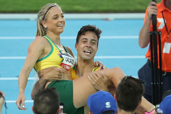 Luke Mathews and Genevieve LaCaze celebrate winning the Mixed 3 Minute race at the Nitro Athletics Meeting in Melbourne (Getty Images)