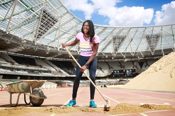 Christine Ohuruogu removing the final protective layer of soil from the finish line in London's Olympic Stadium  (British Athletics)
