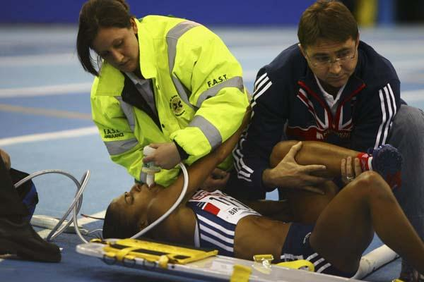 Karen Harewood being assisted by medics in Birmingham (Getty Images)