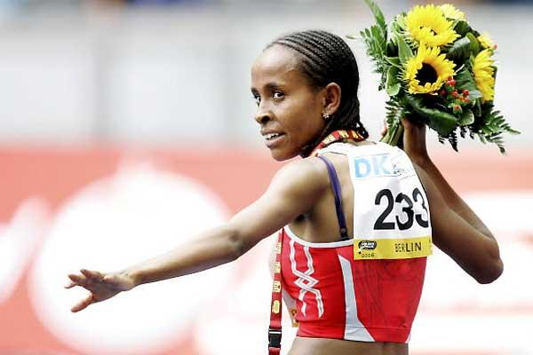 Meseret Defar with her victors flowers after denying Dibaba over 5000m in Berlin (Bongarts / Getty Images)