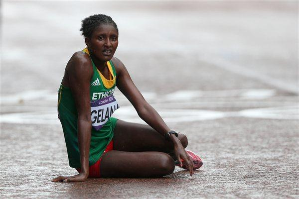 Gold medalist Tiki Gelana of Ethiopia rests at the finish line on The Mall after the Women's Marathon on Day 9 of the London 2012 Olympic Games on August 5, 2012 (Getty Images)