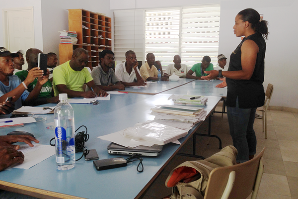 Educating the coaches at the athletics camp in Haiti (NFP Foundation)