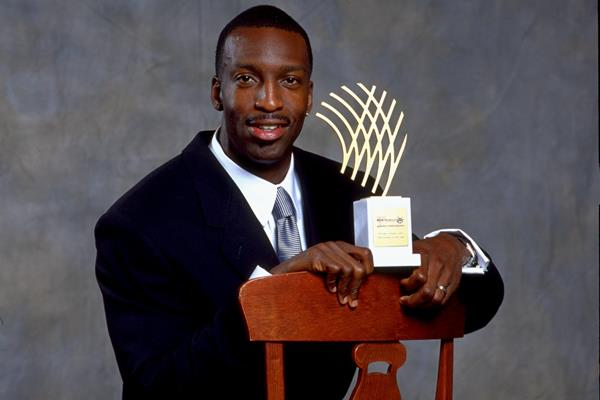 Michael Johnson with his 1999 Athlete of the Year award (Getty Images)