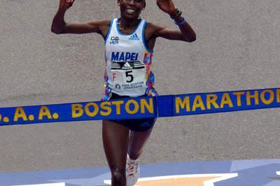 All smiles - Rita Jeptoo (KEN) winning the 2006 Boston Marathon (Getty Images)