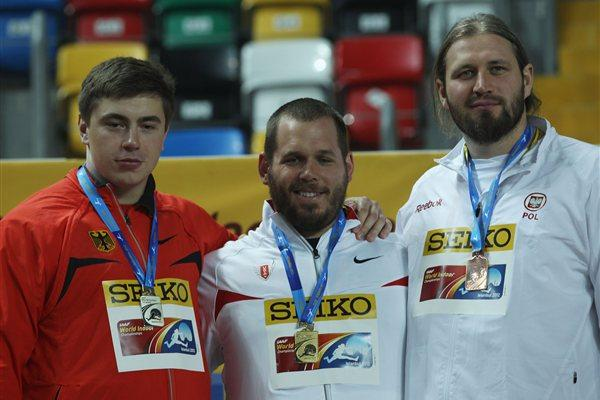 (L-R) Silver medalist David Storl of Germany, gold medalist Ryan Whiting of the United States and bronze medalist Tomasz Majewski of Poland stand on the podium during the medal ceremony for the Men's Shot Put during day one - WIC Istanbul (Getty Images)