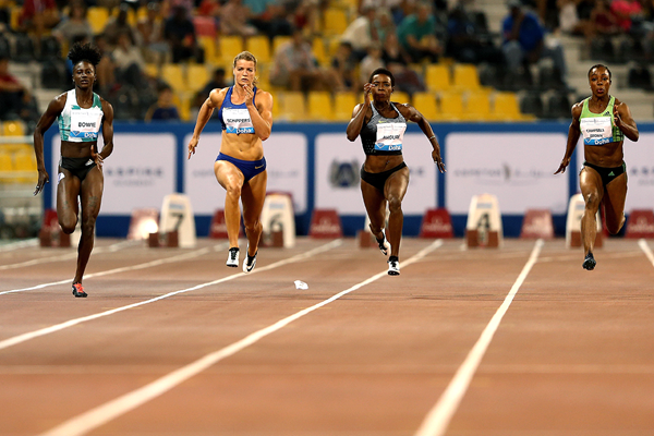 Tori Bowie (left) on her way to winning the 100m at the IAAF Diamond League meeting in Doha (Getty Images)