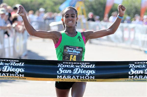 Bizunesh Deba of Ethiopia celebrates winning the San Diego Marathon (Victah Sailer)