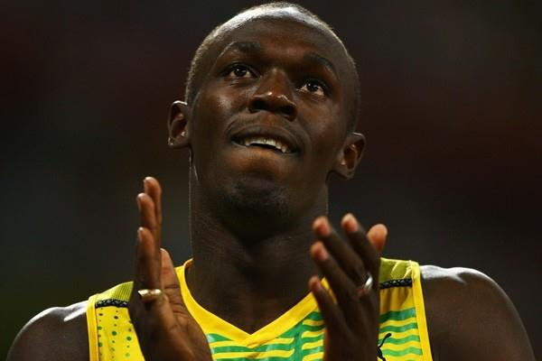 Usain Bolt wins the Olympic 100m title with a world record of 9.69 (Getty Images)