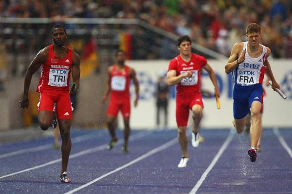 (L-R) Richard Thompson of Trinidad and Tobago and Christophe Lemaître of France in the first of the men's 4x100m heats in Berlin (Getty Images)