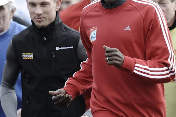 Wilson Kipketer accompanied by Speedway star Andreas Jonsson in Bydgoszcz, Poland (Roman Bosiacki)