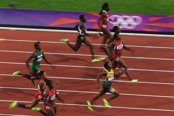 Shelly-Ann Fraser-Pryce of Jamaica, Carmelita Jeter of the United States and Veronica Campbell-Brown of Jamaica race for the line in the Women's 100m Final of the London 2012 Olympic Games on 4 August 2012 (Getty Images)