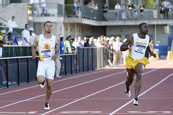 Andre De Grasse wins the 100m from Trayvon Bromell (Randy Miyazaki)