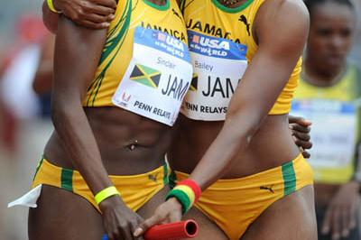 Jamaicans Kenia Sinclair and Aleen Bailey after their Sprint Medley Relay at the Penn Relays (Kirby Lee)
