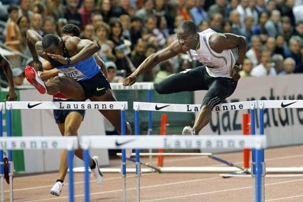 David Oliver and Dayron Robles head to head over the hurdles in Lausanne (Olivier ALLENSPACH/Switzerland)