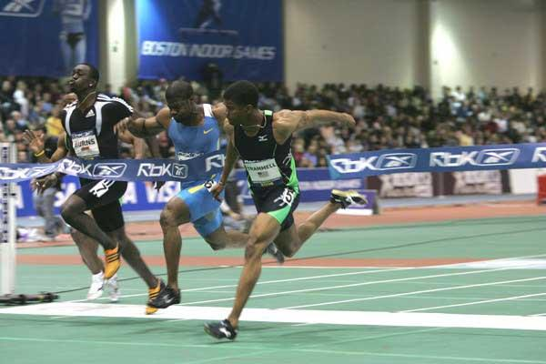 Terrence Trammell dips at the line in the men's 60m - Boston (Victah Sailer)