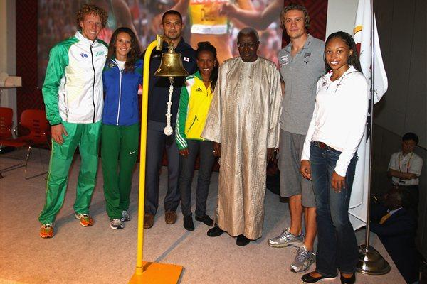 IAAF Athletics' World Plan - President Diack joins, Meseret Defar, Allyson Felix, Fabiana Murer, Steven Hooker, Koji Murofushi, and Andreas Thorkildsen to ring the bell for the 'last lap' of the plan's current activities  (Getty Images)