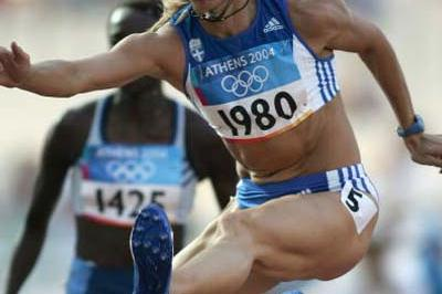 Fani Halkia of Greece sets a new national record to win the heats of the 400m Hurdles (Getty Images)