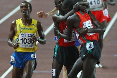 Ezekiel Kemboi , Brimin Kiprop Kipruto and Richard Kipkemboi Mateelong all of Kenya celebrate following the Men's 3000m Steeplechase Final (Getty Images)