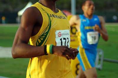 Dexter Lee crossing the line to win the U-17 200m - CARIFTA (Anthony Foster)