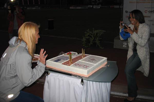 Kelly Holmes takes a photo of Ceplak's 30th Birthday cake in Celje, Slovenia (Bob Ramsak)