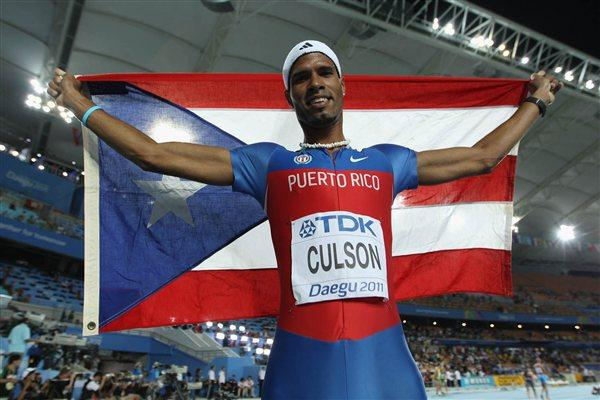 Javier Culson of Puerto Rico celebrates with his country's flag after claiming silver in the men's 400 metres hurdles final (Getty Images)