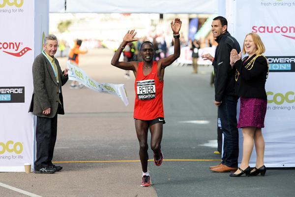 Peter Some wins the 2012 Brighton Marathon; (left) Ron Hill (Mark Shearman)