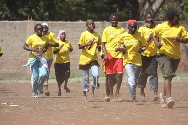 Women competing at the Shoe4Africa race in Kibera slums in the Kenyan capital (Omulo Okoth)