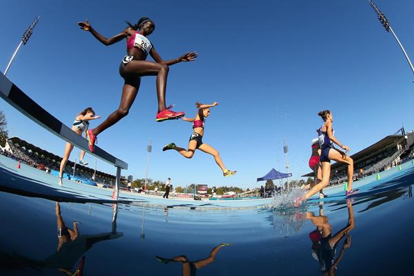 Madeline Heiner (right) on her way to winning the steeplechase in Melbourne (Getty Images)