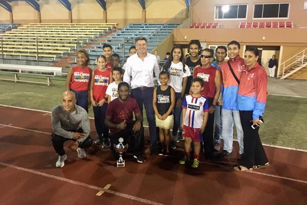 IAAF President Sebastian Coe with local athletes at the national stadium in Oranjestad, Aruba (IAAF)