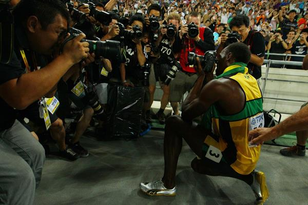 After winning gold in the 200m, Usain Bolt takes a picture of the photographers at the 2011 IAAF World Championships in Daegu (Getty Images)