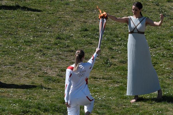 Anna Korakaki,  Rio 2016 shooting gold medallist, receives the Olympic flame during the flame lighting ceremony in ancient Olympia (AFP/Getty Images)